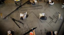 Aerial view of a socially-distanced classroom set up, with engineering design tools interspersed